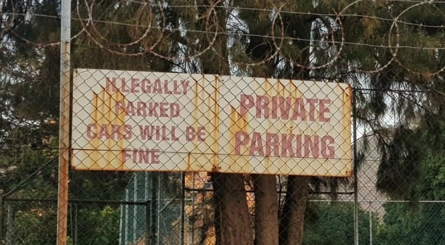 Text - LEGALLY ORKED CAKS WILL B FINE PRWATE PARKING