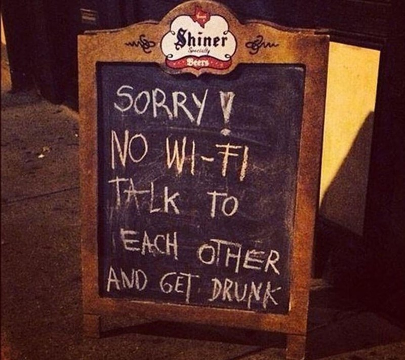 restaurant sign - Font - Shiner) n Scialty Beers 50RRY NO WI-TI TALK TO EACH OTHER AND GET DRUNK