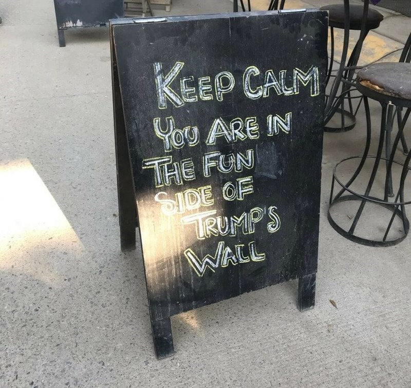 restaurant sign - Text - EEP CALM ARE IN THE FUN SIDE OF RUMPS WALL
