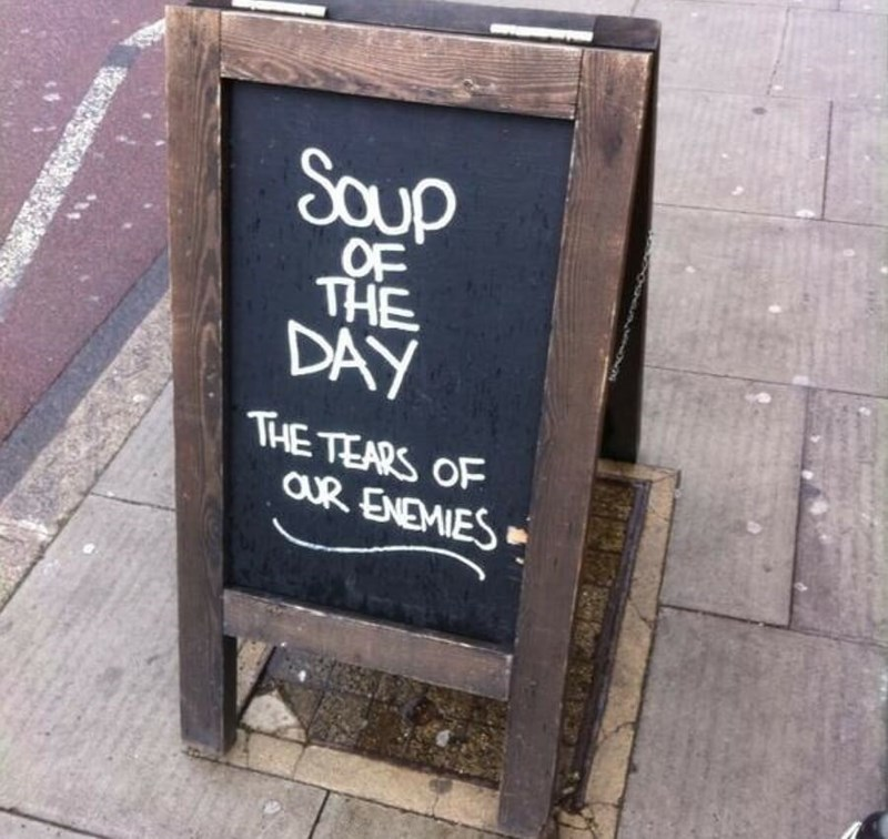 restaurant sign - Text - Saup OF THE DAY THE TEARS OF aUR ENEMIES
