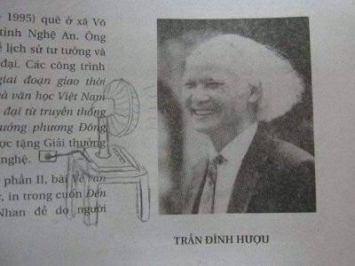 Textbook page showing a photo of an old Asian man with long hair; someone drew a fan making it look like his hair is blowing back behind him