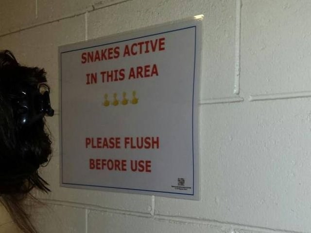 Text - SNAKES ACTIVE IN THIS AREA PLEASE FLUSH BEFORE USE