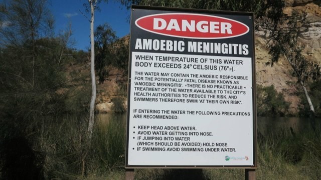 Nature reserve - DANGER AMOEBIC MENINGITIS WHEN TEMPERATURE OF THIS WATER BODY EXCEEDS 24° CELSIUS (76°F). THE WATER MAY CONTAIN THE AMOEBIC RESPONSIBLE FOR THE POTENTIALLY FATAL DISEASE KNOWN AS AMOEBIC MENINGITIS', THERE IS NO PRACTICABLE TREATMENT OF THE WATER AVAILABLE TO THE CITY'S HEALTH AUTHORITIES TO REDUCE THE RISK, AND SWIMMERS THEREFORE SWIM AT THEIR OWN RISK IF ENTERING THE WATER THE FOLLOWING PRECAUTIONS ARE RECOMMENDED: KEEP HEAD ABOVE WATER AVOID WATER GETTING INTO NOSE IF JUMPING