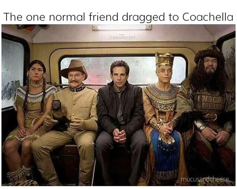 Night at the Museum cast of historical figures with Ben Stiller in normal clothes sitting in the middle