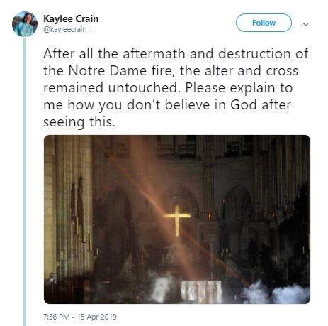 """Original tweet that reads, """"After all the aftermath and destruction of the Notre Dame fire, the alter and cross remained untouched. Please explain to me how you don't believe in God after seeing this"""" above a pic of the cross still standing in Notre Dame"""