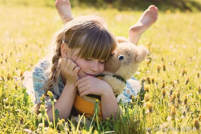 Stock Photo of Little Girl in a Field