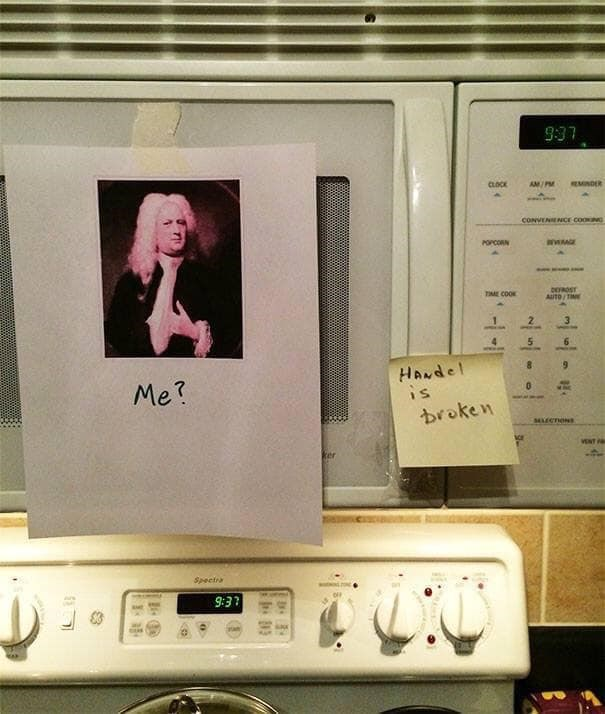 """Pic of a microwave with a post-it note that reads, """"Handel is broken;"""" someone taped a pic of Handel and text """"Me?"""" next to it"""