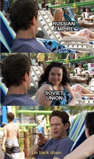 "Panel images from 'It's Always Sunny' where Dennis is looking at an attractive woman, who represents ""Russian empire;"" a less attractive woman in the middle image represents ""Soviet Union,"" and in the last image Dennis says, ""Lie back down"""