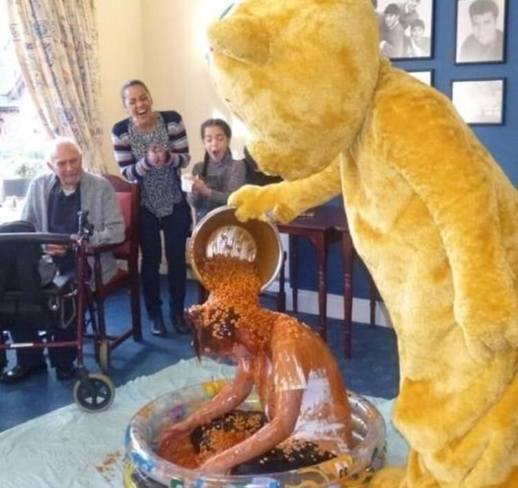 cursed_image - pouring beans on person by person in costume