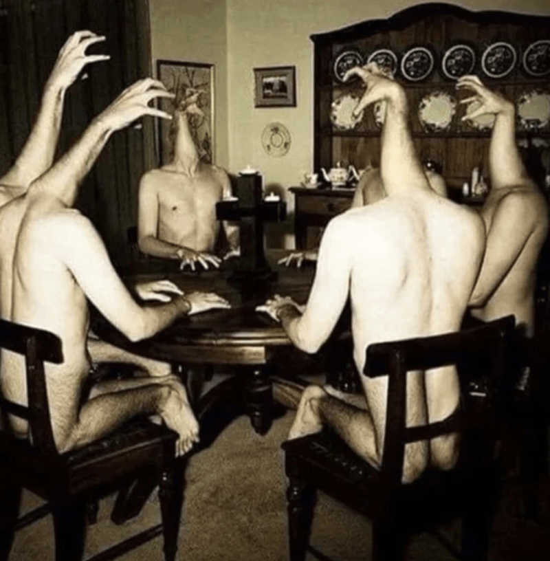 cursed_image - Room with arms around a table