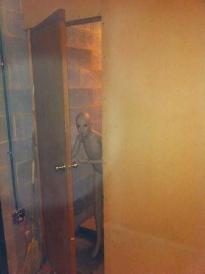 cursed_image-creepy doll opens door