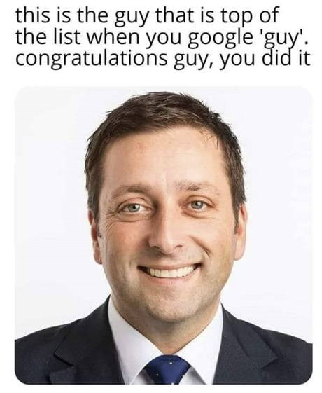 "Caption that reads, ""This is the guy that is top of the list when you Google 'guy.' congratulations guy, you did it"" above a stock image of a guy smiling"