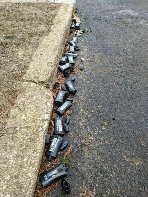 cursed image - bottles of shampoo on street