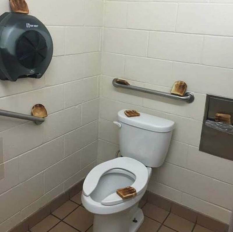 cursed_images - Toilet pieces of toast bread