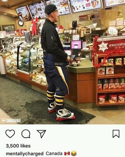 """Funny Instagram photo of a guy wearing hockey skates in a convenience store with caption that reads, """"Canada"""""""