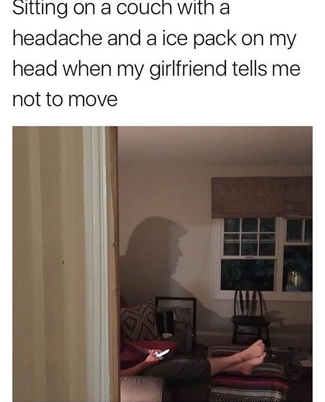 """Caption that reads, """"Sitting on a couch with a headache and an ice pack on my head when my girlfriend tells me not to move"""" above a funny photo of someone sitting on the couch with a shadow in the background that looks like Donald Trump"""