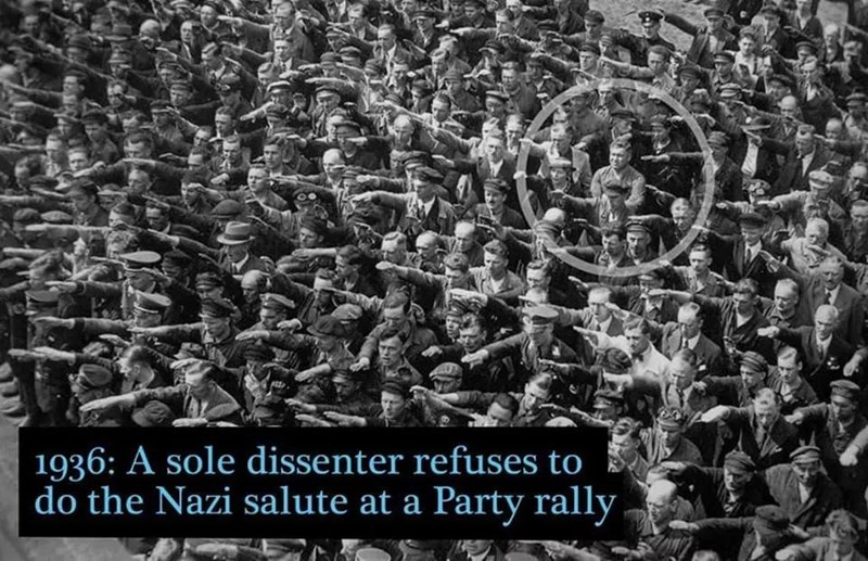 People - 1936: A sole dissenter refuses to do the Nazi salute at a Party rally
