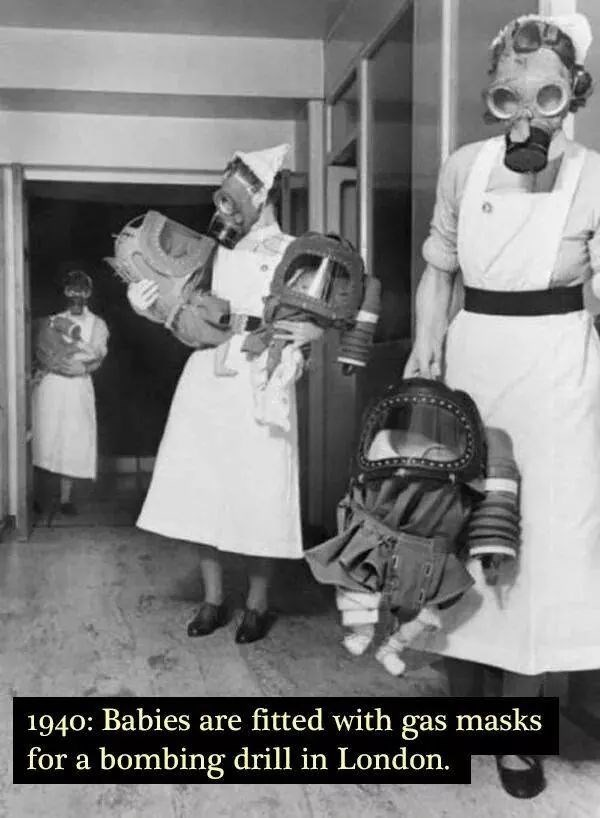 Photograph - 1940: Babies are fitted with gas masks for a bombing drill in London.