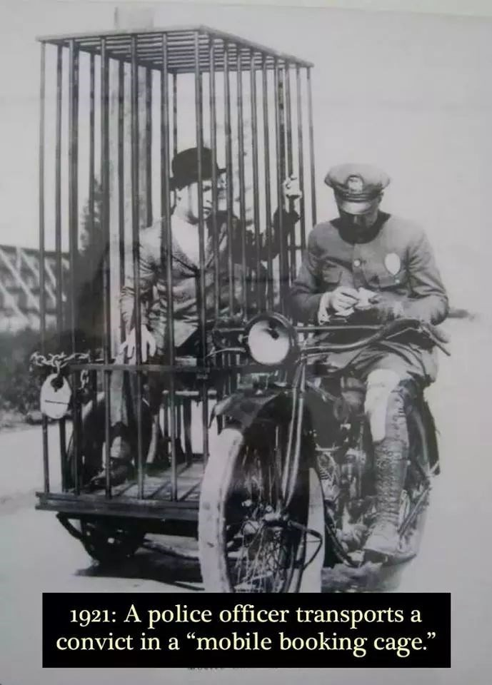 """Motor vehicle - 1921: A police officer transports a convict in a """"mobile booking cage."""""""