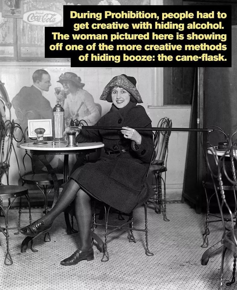Sitting - Coca-Cola During Prohibition, people had to get creative with hiding alcohol. The woman pictured here is showing off one of the more creative methods Deink of hiding booze: the cane-flask.