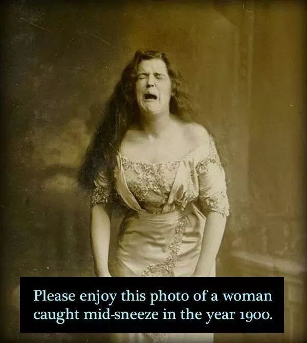 Facial expression - Please enjoy this photo of a woman caught mid-sneeze in the year 1900.