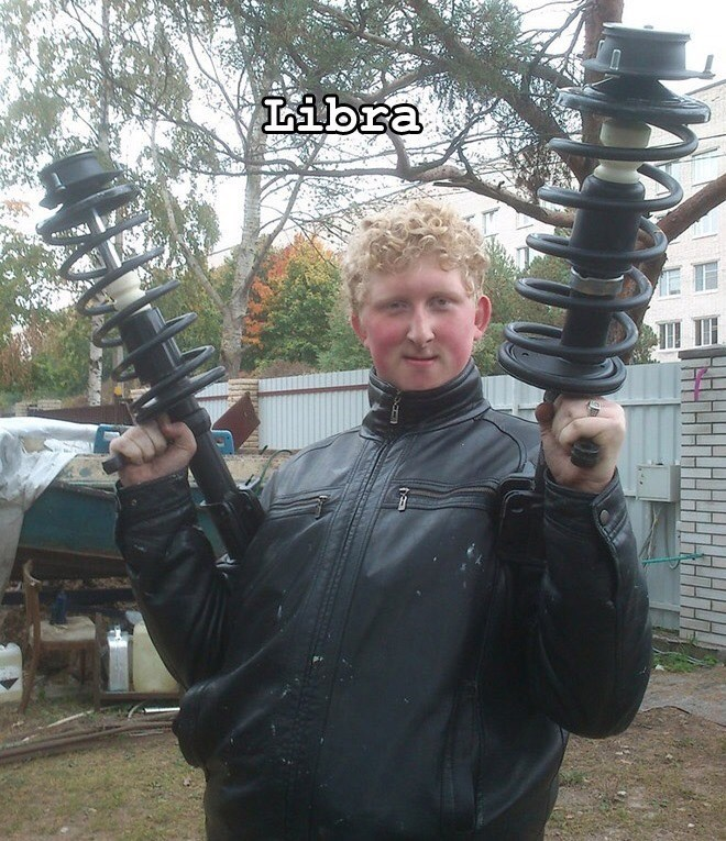 teenage boy wearing black leather jacket holding swirly electric device in each hand