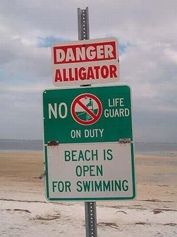 Sign - DANGER ALLIGATOR LIFE GUARD NO ON DUTY BEACH IS OPEN FOR SWIMMING