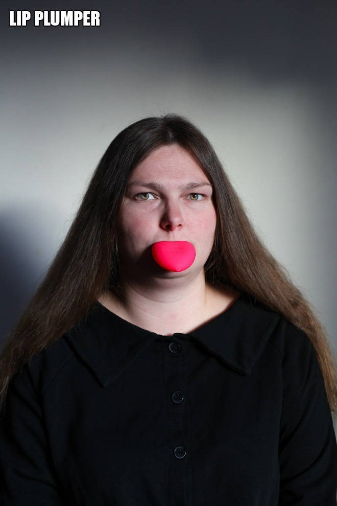 """Funny pic of a woman modeling a """"lip plumper"""""""