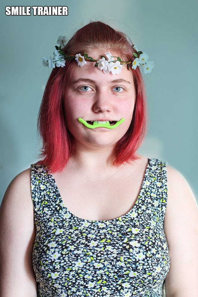 """Funny pic of a woman modeling a """"smile trainer"""""""