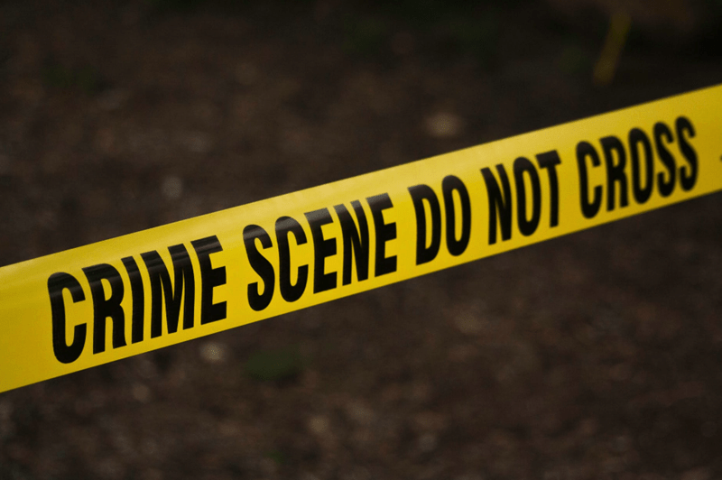 An image of crime scene tape, and a box of text about woman getting arrested by the CIA.