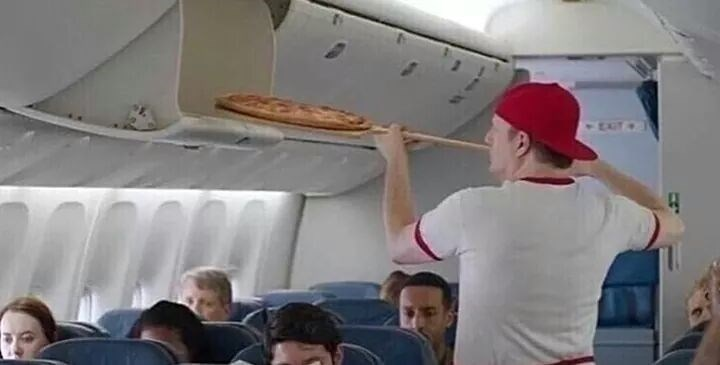 cursed image - Airline pizza on plane