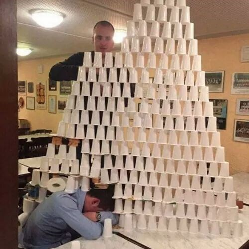 cursed image - Architecture pile of cups on a person
