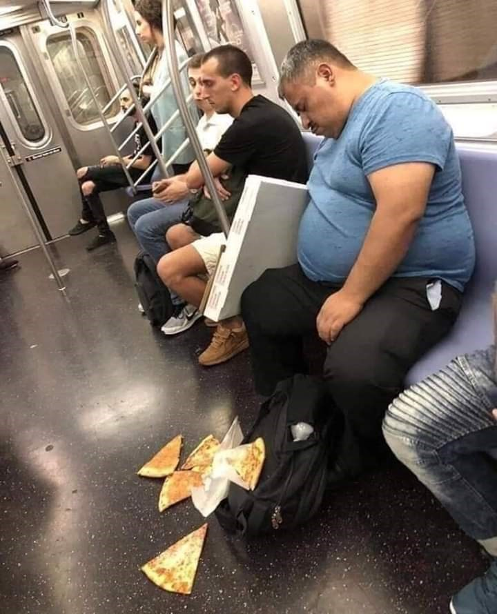 cursed image - pizza falling out of the box on a train