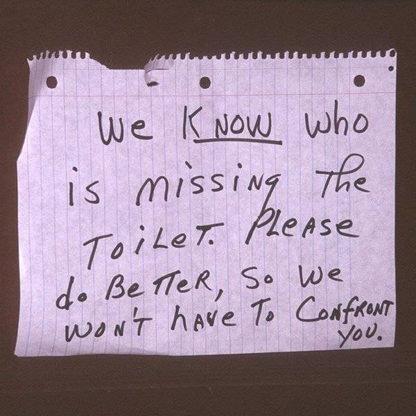 """Funny sign that reads, """"We know who is missing the toilet. Please do better, so we won't have to confront you"""""""