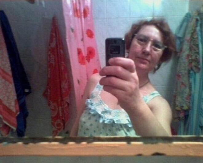 woman taking a mirror selfie