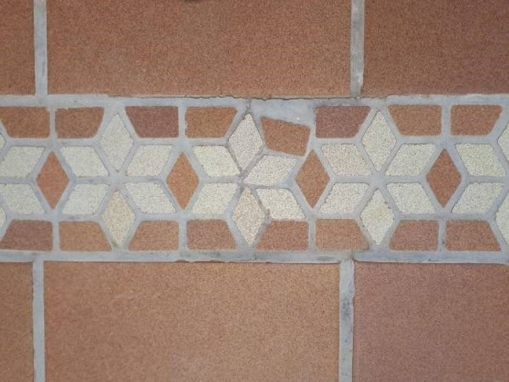 Photo of some mosaic tiles where some of the tiles don't fit together