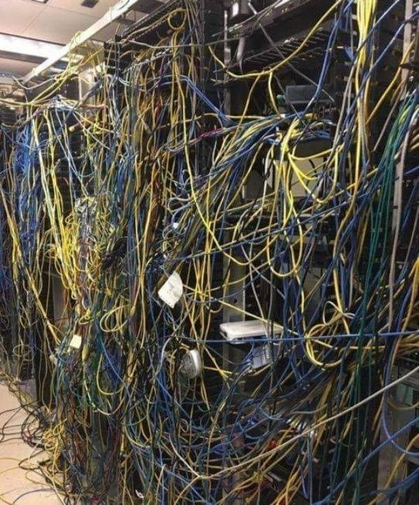 Photo of a maintenance room with tons of wires sticking out everywhere