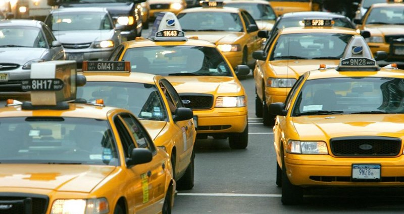 many yellow taxi cabs stuck in a traffic jam at the JFK airport