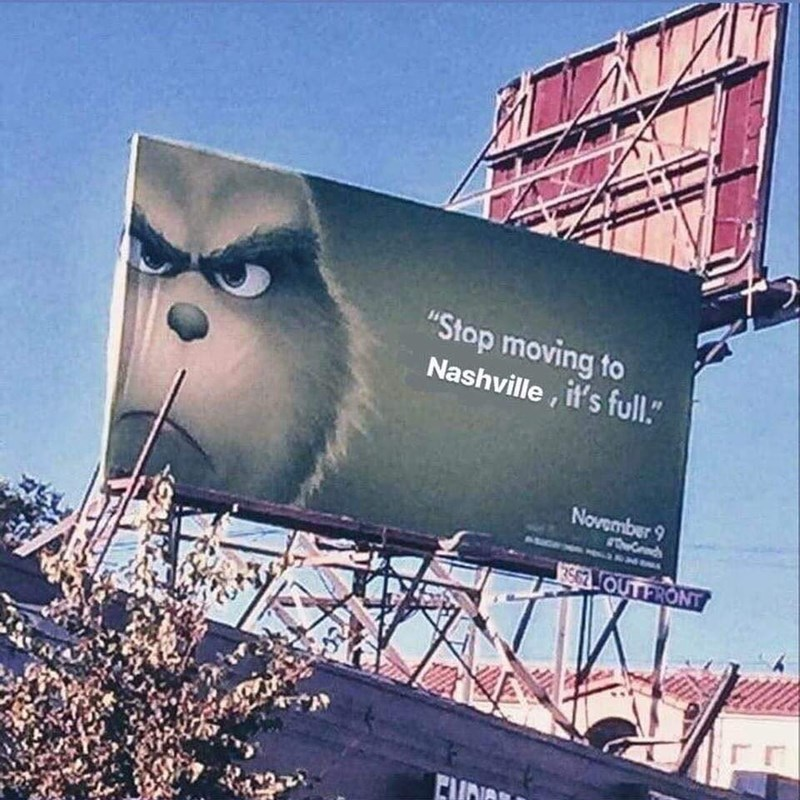 """Photo of a billboard that reads, """"Stop moving to Nashville, it's full"""""""