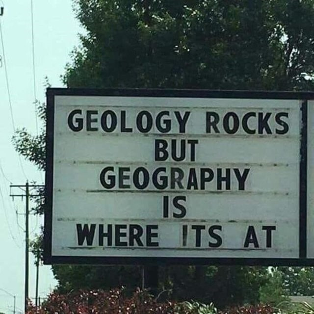 sign saying GEOLOGY ROCKS BUT GEOGRAPHY IS WHERE ITS AT