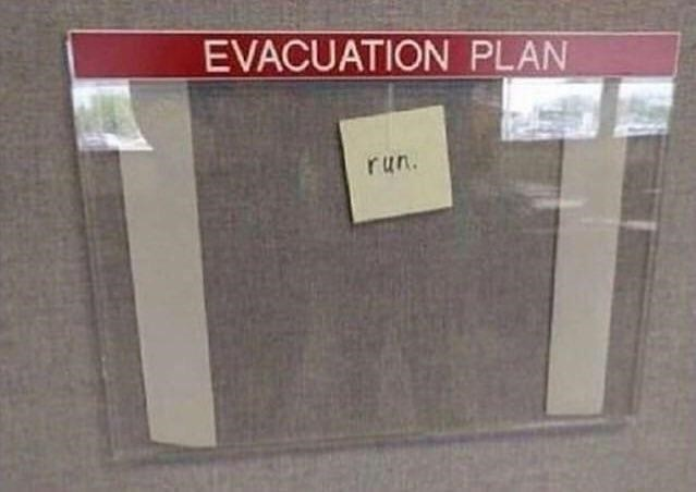clear folder labelled EVACUATION PLAN with small post it note inside saying run