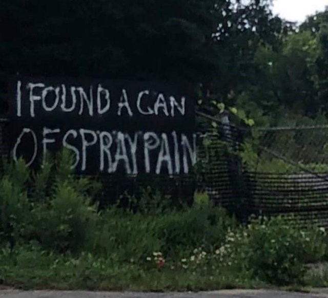wall with white graffiti saying i found a can of spray paint