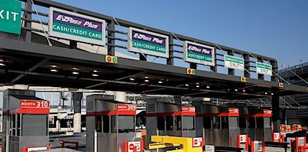 a payment toll for cars leaving parking lots at JFK airport, which say cash/credit card