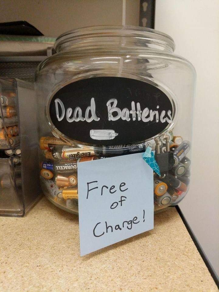 Funny photo of a bucket of dead batteries that are 'free of charge'