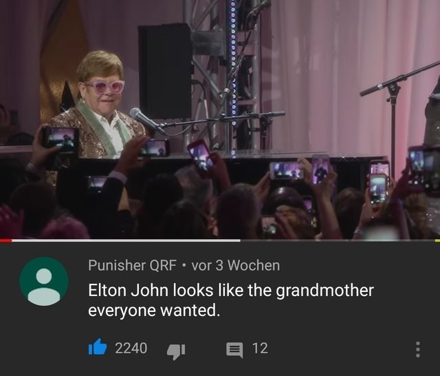 Reddit memes: Meme of elton john sitting at a piano in a youtube video, commenter says that elton john looks like the grandmother everyone wanted.