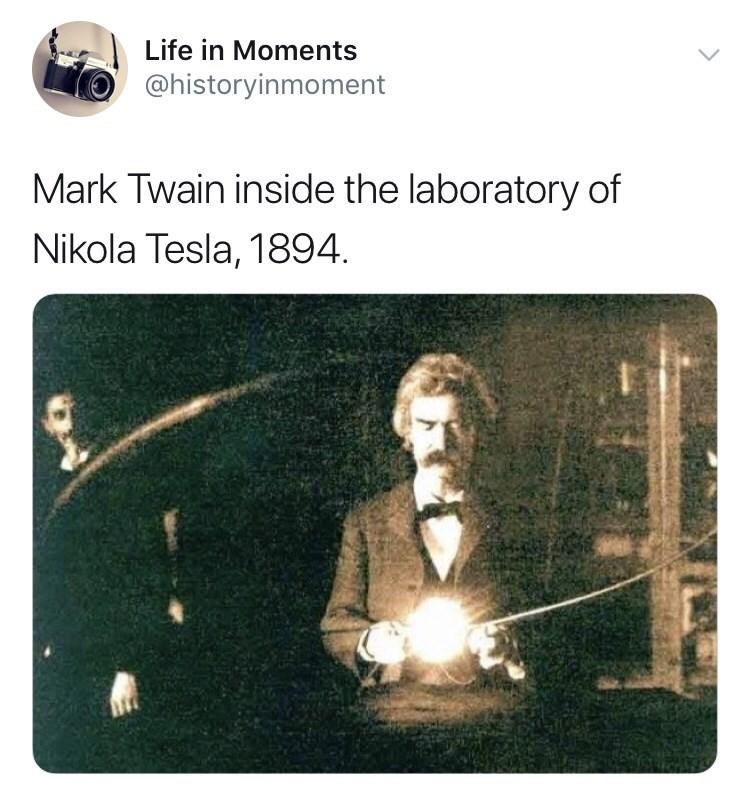 Interesting history photo - Text - Life in Moments @historyinmoment Mark Twain inside the laboratory of Nikola Tesla, 1894