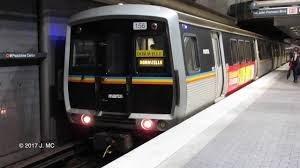 a grey MARTA train pulls into an underground train station