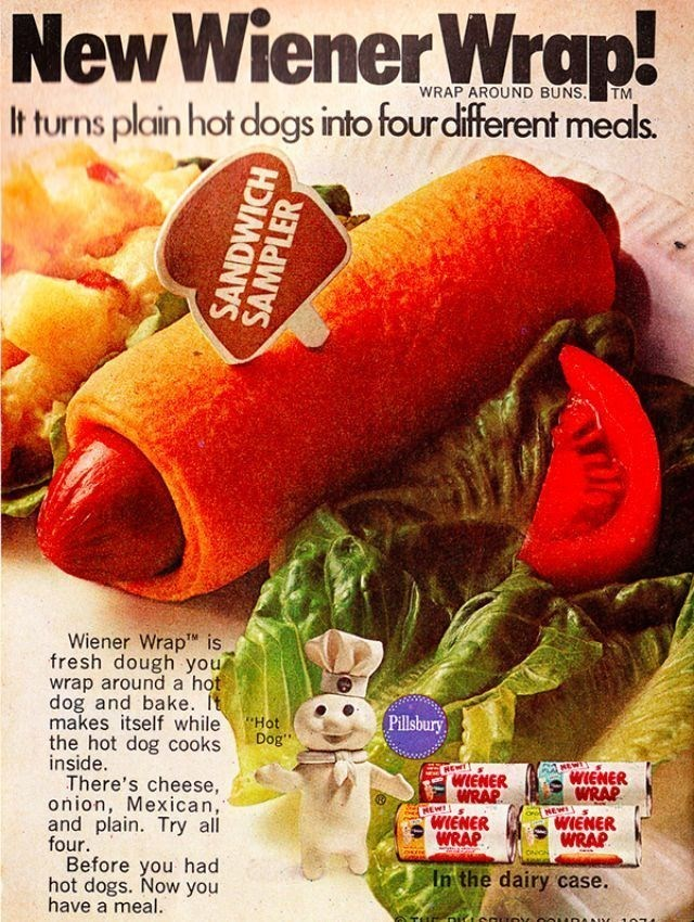 """vintage advertisement - Food - NewWiener Wrap. WRAP AROUND BUNS. TM It turns plain hot dogs into four different meals. Wiener Wrap is fresh dough you wrap around a hot dog and bake. It makes itself while the hot dog cooks inside. There's cheese, onion, Mexican, and plain. Try all four Before you had hot dogs. Now you have a meal. Pillsbury """"Hot Dog MEW WIENER HEWT WIENER WRAP WRAP WIENER WRAP REW WIENER WRAP In the dairy case. SANDWICH SAMPLER"""