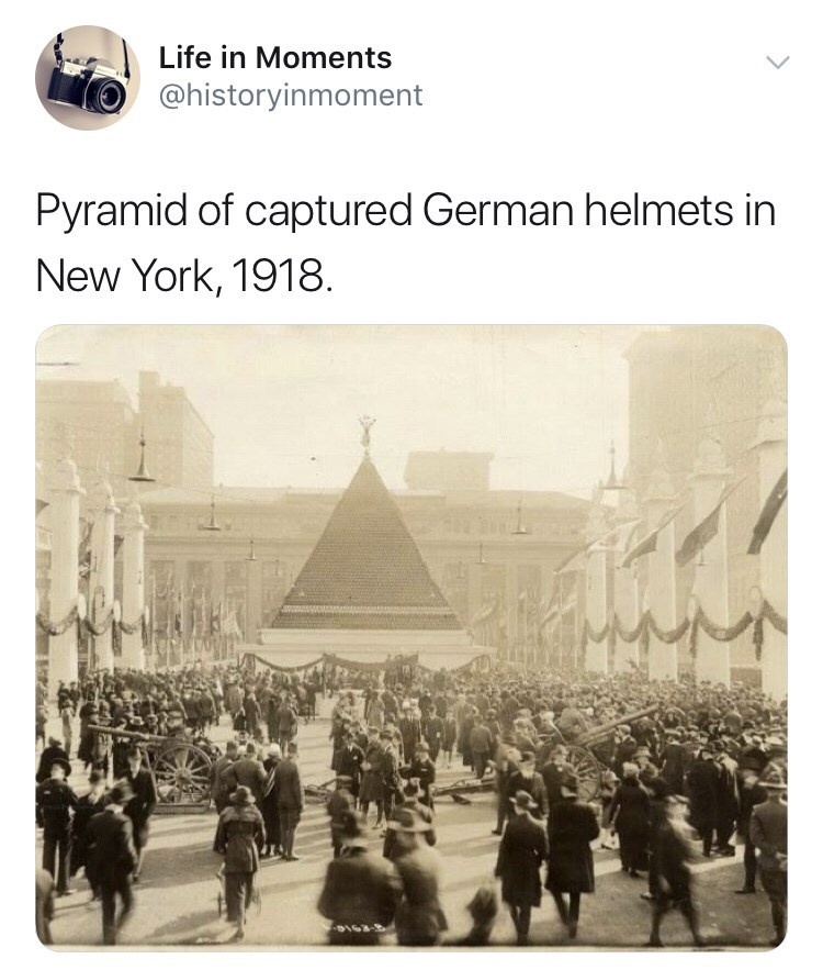 Text - Life in Moments @historyinmoment Pyramid of captured German helmets in New York, 1918