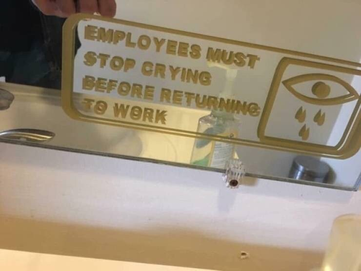 """Funny photo of a sign that reads, """"Employees must stop crying before returning to work"""""""